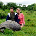 Rod, Christi and a shy giant tortoise, highlands of Santa Cruz Island Galapagos Islands Ecuador