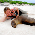 Sea lion is unfazed by Christi's close proximity, Española Island, Galápagos Islands, Ecuador