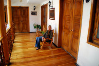 Christi sits outside our room at the hostel in Cuenca