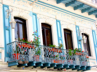Colonial-style balcony with exquisite stucco and wrought-iron detail, Cuenca, Ecuador