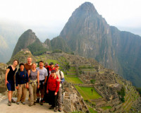 Inca trail survivors gather for a Machu Picchu photo, Peru