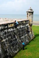 Invasion! Local kids scale the ramparts in Cartagena, Colombia