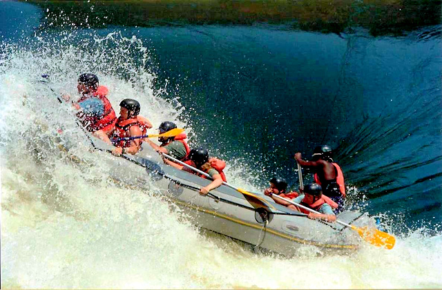 Rafting the Nile at Jinja (note the water level is above the raft!), Uganda, Africa