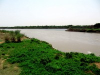 The confluence of the Blue Nile [right] and White Nile [left] from the White Nile Bridge, Sudan, Africa